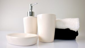 clean bathroom items against neutral background